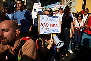 Protestors march towards the Portuguese parliament in Lisbon holding banners and shouting slogans Saturday, Oct. 15 2011. Demonstrators marched Saturday in European cities as protests against capitalism and austerity measures went global.