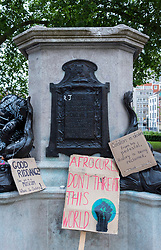 © Licensed to London News Pictures; 11/06/2020; Bristol, UK. Signs can be seen left at the now empty plinth where the statue of 17th century slave trader and Bristol philanthropist Edward Colston used to stand. At a Black Lives Matter protest the previous Sunday the statue of slave trader Edward Colston which has stood in Bristol city centre for over 100 years was pulled down with ropes and thrown in Bristol Docks by protesters during the BLM rally and march through the city centre in memory of George Floyd, a black man who was killed on May 25, 2020 in Minneapolis in the US by a white police officer kneeling on his neck for nearly 9 minutes. Edward Colston (1636 – 1721) was a wealthy Bristol-born English merchant involved in the slave trade, a Member of Parliament and a philanthropist. He supported and endowed schools, almshouses, hospitals and churches in Bristol, London and elsewhere, and his name is commemorated in several Bristol landmarks, streets, three schools and the Colston bun. The killing of George Floyd has seen widespread protests in the US, the UK and other countries. Photo credit: Simon Chapman/LNP.