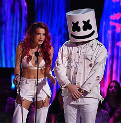 LOS ANGELES - AUGUST 13: Bella Thorne (L) and Marshmello  onstage at FOX's 'Teen Choice 2017' at the Galen Center on August 13, 2017 in Los Angeles, California. (Photo by Frank Micelotta/FOX/PictureGroup) *** Please Use Credit from Credit Field ***