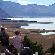 People on top of Mount John overlooking Lake Tekapo and the Mackenzie Country, South Island, New Zealand. 24th February 2011, Photo Tim Clayton
