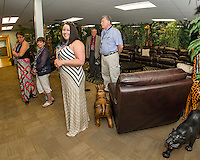 Sales Floor Manager Karen Keeler walks town of Moultonboro employees on a tour through the Zen Room at CruCon's facility during the VIP Pre Opening on Saturday evening.  (Karen Bobotas/for the Laconia Daily Sun)