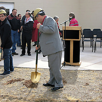 Michael Sullivan/Independent                  Grants Cibola School Supt. Kilino Marquez fills in holes after groundbreaking for the Grants High School Performing Arts Center expansion.