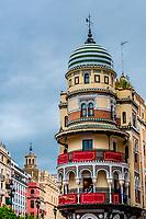The Adriatic Building (Edificio de la Adriatica) on Avenue de la Constitucion (adjacent to Plaza San Francisco). Built in 1922: architect: Jose Espiau Munoz. With rounded balconies, it is built in the Neo-Mudejar style. Seville, Andalusia, Spain.