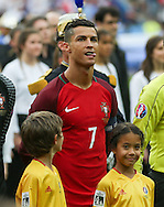 Young boy mascot sees Portugal Forward Cristiano Ronaldo poke his tongue out during the Euro 2016 final between Portugal and France at Stade de France, Saint-Denis, Paris, France on 10 July 2016. Photo by Phil Duncan.