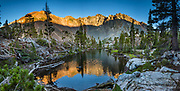 Sierra peaks lit by sunset reflect in a pond south of Nutter Lake in Hoover Wilderness of Humboldt-Toiyabe National Forest, Eastern Sierra Nevada, Mono County, California, USA. Our backpack from Green Creek Trailhead to Summit Lake was 7.6 mi with 2360 ft gain, 310 ft descent, over a leisurely 3 days, then out on the fourth day. A day hike from our Green Lake campsite to West Lake was 3.9 mi with 1830 ft gain to 8896 ft elev. From Summit Lake, we day hiked east to Burro Pass with a view to Virginia Lakes (2180 ft gain over 4 miles round trip). Multiple overlapping photos were stitched to make this panorama.