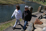 Dorene Moser, left, of Bethlehem Township, and her husband Keith Moser, right, of Bethlehem Township, take a walk Mar. 21, 2020, at Monacacy Park in Bethlehem, Pennsylvania. The couple took the opportunity to get out of the house where they have been mainly staying inside in recent days. Keith works from home as a trucking salesman and usually goes out to meet with clients, though he has been forced to adjust as he is unable to meet with anyone he does business with now. Communities across the Lehigh Valley are adjusting to life during the coronavirus pandemic that is impacting the daily lives of Pennsylvania residents both socially and economically. (Photo by Matt Smith)
