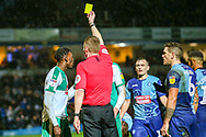Wycombe Wanderers forward Fred Onyedinma(19) receives a yellow card following a challenge pn Wycombe Wanderers goalkeeper Ryan Allsop(1) during the EFL Sky Bet League 1 match between Wycombe Wanderers and Plymouth Argyle at Adams Park, High Wycombe, England on 26 January 2019.