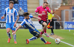 Jon Taylor of Peterborough United is stopped by Joe Edwards of Colchester United - Mandatory by-line: Joe Dent/JMP - 16/04/2016 - FOOTBALL - Weston Homes Community Stadium - Colchester, England - Colchester United v Peterborough United - Sky Bet League One