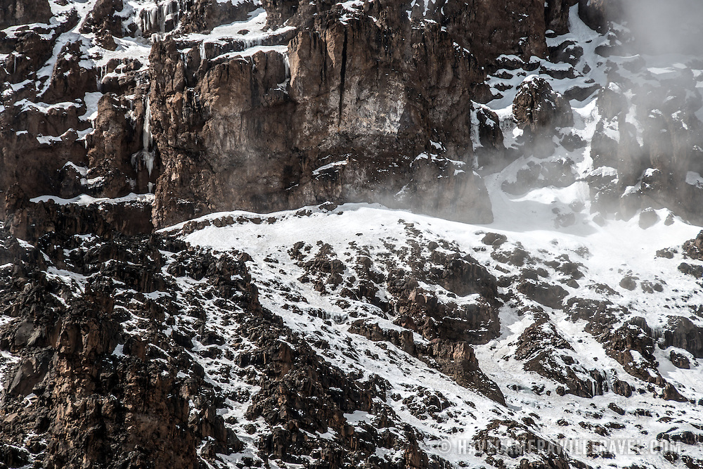 Snow and ice on the rugged cliff face of the Western Breach on Mt Kilimanjaro.
