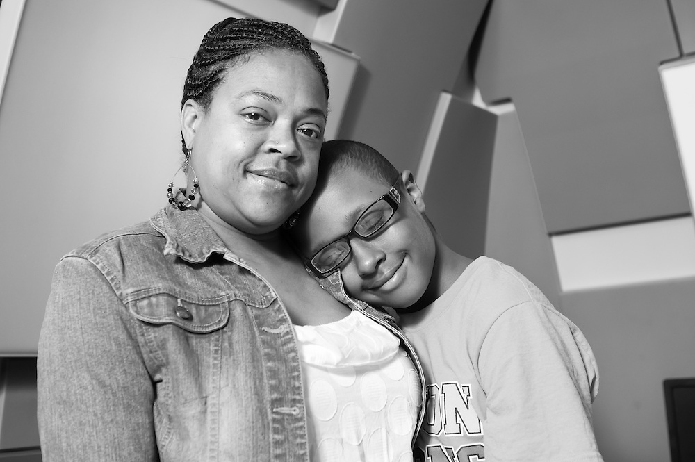 A young boy and his mother photographed for Flashes of Hope at the Children's Floating Hospital in Boston, MA.