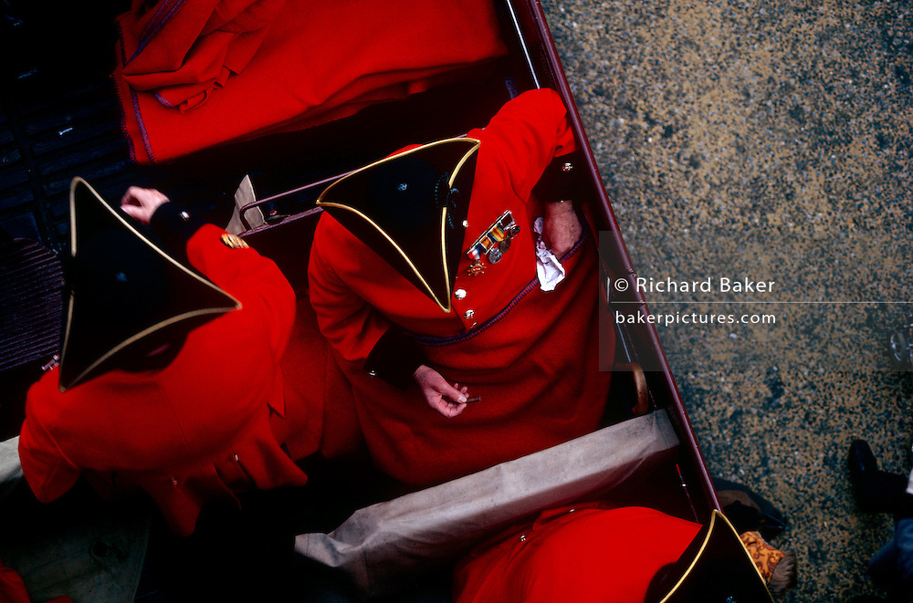 A group of elderly Chelsea Pensioners are seen from high above, as an aerial view, as they sit on board an open-top bus as they prepare to parade through the streets of London, during the annual Lord Mayor's Show. A Chelsea pensioner is an in-pensioner at the Royal Hospital Chelsea, a retirement home and nursing home for former members of the British Army located in Chelsea, London. Historically, however, the phrase applied more widely, referring to both in-pensioners and out-pensioners.