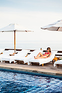 A guest lounges by the pool at the Hotel Punta Islita, Costa Rica.