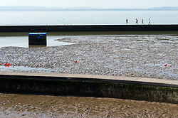 © Licensed to London News Pictures;21/07/2021; Clevedon, UK. Views of Clevedon Marine Lake on one of the hottest days of the year with a national extreme heat warning. The lake has been drained because of an issue with water quality after high levels of bacteria were found in the water. The increase in bacteria has been attributed to the hot weather and the number of people using the lake which disturbs the mud on the bottom which contains bacteria and clouds the water so the sunlight cannot kill the bacteria. Tests have revealed the water does not meet European guidelines. It is hoped the lake will be refilled by overtopping tides this weekend. Photo credit: Simon Chapman/LNP.
