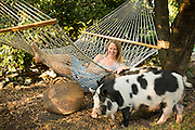 Jessi with her Kunekune cross pet pigs