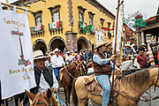 Mexican cowboys gather on horseback for Catholic Mass in the Garden Allende at the end of their pilgrimage celebrating the festival of Saint Michael in San Miguel de Allende, Mexico.