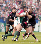 Leicester, Walker Stadium., Leicestershire, 5th April 2004, Heineken Cup, ENGLAND. [Mandatory Credit: Photo  Peter Spurrier/Intersport Images],Heineken Cup, Semi Final, Leicester Tigers vs Stade Toulouse, Walker Stadium, Leicester, ENGLAND: Tiger Henry Tuilagi hands of the challenge from Frederic Michalak.