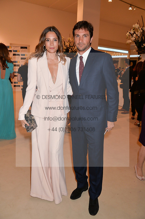 ASTRID MUNOZ and EDUARDO NOVILLO ASTRADA at the Masterpiece Marie Curie Party supported by Jeager-LeCoultre held at the South Grounds of The Royal Hospital Chelsea, London on 30th June 2014.
