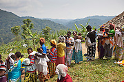 Women line up to vaccinate their children. Bwindi Community hospital medical staff run an out reach clinic in Kitahurira, the only Batwa tribe settlement in Mpungu district. As well as nutrition and vaccination programs they also monitor all the babies health.