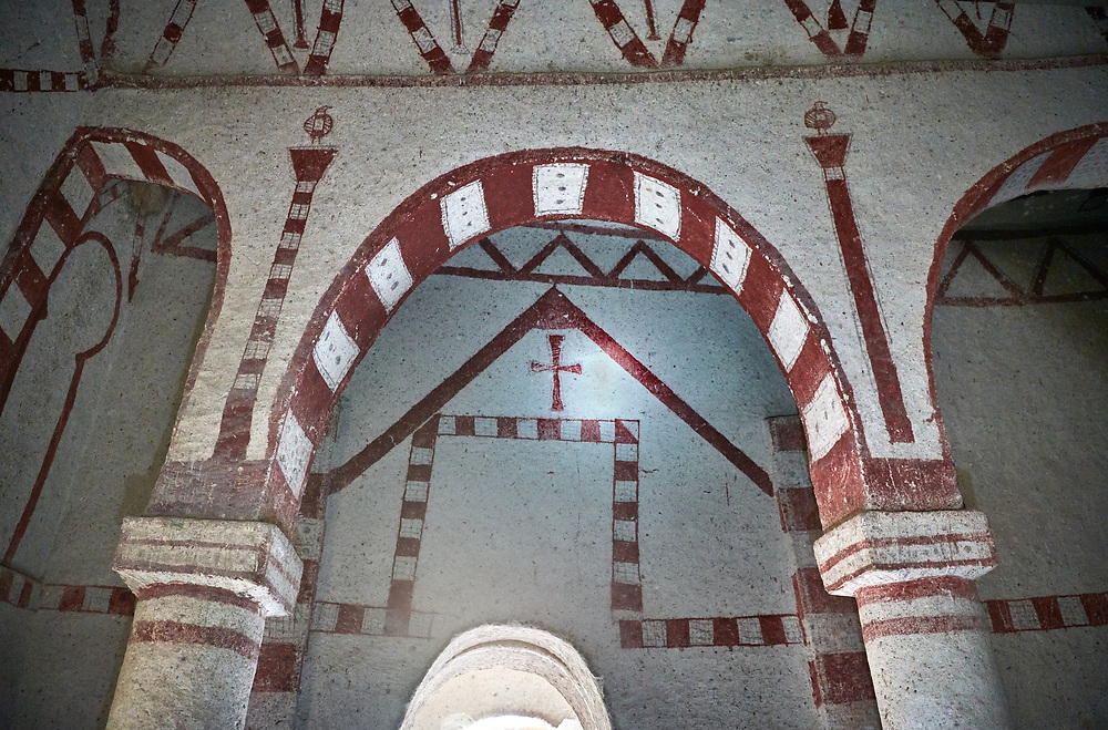 Pictures & images of Aynali Kilise (Church) cave church interior frescoes, iconoclastic period (725-842), near Goreme, Cappadocia, Nevsehir, Turkey<br /> <br /> During the iconoclastic period (725-842) it was forbidden to depict any religious figures in the Orthodox Church so interiors were decorated with simple red and white geometric patterns and crosses. .<br /> <br /> If you prefer to buy from our ALAMY PHOTO LIBRARY  Collection visit : https://www.alamy.com/portfolio/paul-williams-funkystock/cappadociaturkey.html (TIP refine search - enter Aynali Kilise a into the LOWER search box)<br /> <br /> Visit our TURKEY PHOTO COLLECTIONS for more photos to download or buy as wall art prints https://funkystock.photoshelter.com/gallery-collection/3f-Pictures-of-Turkey-Turkey-Photos-Images-Fotos/C0000U.hJWkZxAbg
