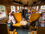 20 MARCH 2015 - PRACHINBURI, PRACHINBURI, THAILAND: A snack vendor  on the 3rd class train going to Kabin Buri. The State Railways of Thailand (SRT), established in 1890, operates 4,043 kilometers of meter gauge track that reaches most parts of Thailand. Much of the track and many of the trains are poorly maintained and trains frequently run late. Accidents and mishaps are also commonplace. Successive governments, including the current military government, have promised to upgrade rail services. The military government has signed contracts with China to upgrade rail lines and bring high speed rail to Thailand. Japan has also expressed an interest in working on the Thai train system. Third class train travel is very inexpensive. Many lines are free for Thai citizens and even lines that aren't free are only a few Baht. Many third class tickets are under the equivalent of a dollar. Third class cars are not air-conditioned.  PHOTO BY JACK KURTZ