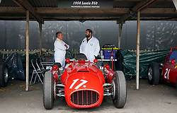 © Licensed to London News Pictures. <br /> 13/09/2019.  <br /> Goodwood.West, Sussex. UK.<br /> The Goodwood Motor Circuit celebrates the 21st year of the Revival.This has become one of the biggest annual historic motorsport events in the world and the only one to be staged entirely in period dress. Each year over 150,000 people descend on this quiet corner of West Sussex to enjoy the three-day event.<br /> Pictured. Mechanics talk behind 1954 Lancia.<br /> <br /> <br /> Photo credit: Ian Whittaker/LNP