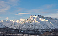 Sunrise light on the Chugach Mountains and the Matanuska Valley in Southcentral Alaska. Winter.
