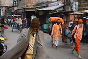 Men on their way to the Ganges River, Varanasi, India