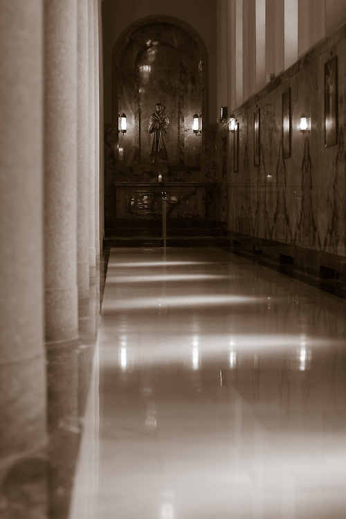 Chapel with marble pillars and floor illuminated with beautiful light.