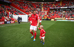 Charlton Athletic's Jason Pearce with his children as match day mascots