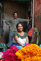 """MEXICO, Veracruz, Tantoyuca, Oct 27- Nov 4, 2009. Flower vendors in Huejutla's main """"mercado"""" with their colorful offerings. """"Xantolo,"""" the Nahuatl word for """"Santos,"""" or holy, marks a week-long period during which the whole Huasteca region of northern Veracruz state prepares for """"Dia de los Muertos,"""" the Day of the Dead. For children on the nights of October 31st and adults on November 1st, there is costumed dancing in the streets, and a carnival atmosphere, while Mexican families also honor the yearly return of the souls of their relatives at home and in the graveyards, with flower-bedecked altars and the foods their loved ones preferred in life. Photographs for HOY by Jay Dunn."""