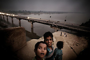 Five hundred million people, about 8 percent of the world's population, live in the Ganges basin. According to a UN report, India occupies the third place in the ranking of 122 countries with the worst quality of water.The recent report of a U.S. agency forecasts, by 2030, the death of Indian sacred river because of global warming, water pollution and construction of dams along the river..Ganges death not only will ravage the economy of that area but, moreover, it will affect deeply the local people spiritual life, with its ancient rituals and traditions October 30, 2008,  Kanpur is one of the most polluted city in India..Ganga Pollution along Kanpur, India.