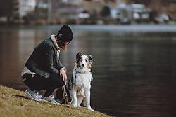 THEMENBILD - eine Frau mit ihrem Australian Shepherd am Ufer des Zeller Sees, aufgenommen am 09. März 2021, Zell am See, Österreich // a woman with her Australian Shepherd on the shore of Lake Zell, Zell am See, Austria on 2021/03/09. EXPA Pictures © 2021, PhotoCredit: EXPA/ JFK