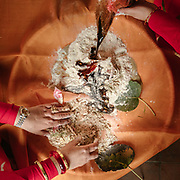 On the Second day of the wedding, guests are preparing offerings made of flour for the bride and groom.