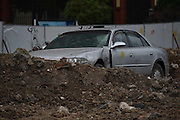 HEFEI, CHINA - JUNE 04: (CHINA OUT) <br /> <br /> Car sits In middle of Construction Site<br /> <br /> A Buick car stands at construction site where its four rounds were dug near Wangjiang Road on June 4, 2015 in Hefei, Anhui province of China. The car had been there for more than three months and nobody claimed as owner when the construction started<br /> ©Exclusivepix Media