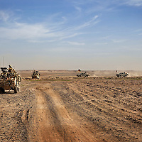 A convoy of Jackal armored fighting vehicles and Ford Rangers transport British soldiers of 16 Air Assault Bde's elite BRF (Brigade Reconnaissance Force) and members of the Afghan Special Forces across the desert to an operation in the village of Kakaran in Helmand Province, Southern Afghanistan on the 15th of March 2011.