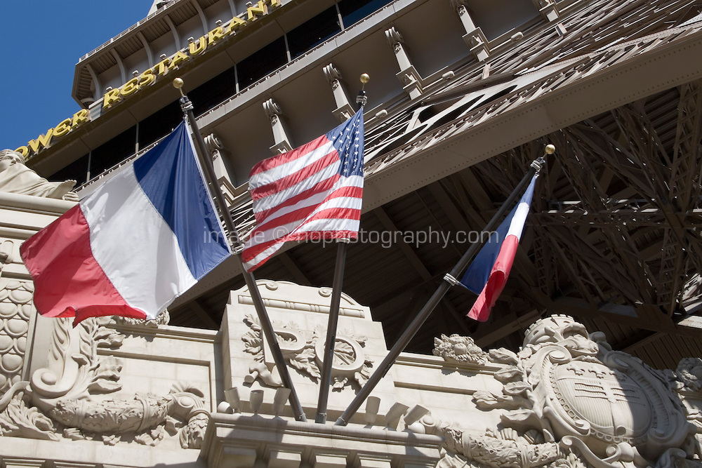 american and french flags at the Paris hotel and casino on Las Vegas Boulevard, Las Vegas, Nevada. The street is also known as The Las Vegas Strip where many of the famous themed casinos and hotels are located.