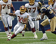 Washington Redskins running back Rock Cartwright (L) rushes upfeild for a 28-yard gain, as St. Louis Rams defensive back Ron Bartell (R) moves in for a tackle in the second quarter, during the Redskins 24-9 win at the Edward Jones Dome in St. Louis, Missouri, December 4, 2005.