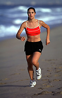 Apr 02, 2003; Huntington Beach, CA, USA; Model ANDREA WILSON goes for an early morning workout run on the beach.  Stock Photo. Model release available upon request. <br />Mandatory Credit: Photo by Shelly Castellano/ZUMA Press.<br />(©) Copyright 2003 by Shelly Castellano