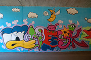 Donald Duck Graffiti on a wall in an underpass. Photographed on the Inn River cycling path, Tyrol, Austria