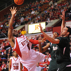 Mar 7, 2009; Piscataway, NJ, USA; Rutgers guard Anthony Farmer (2) scores a basket while falling down during the first half of Rutgers' senior day game against South Florida at the Louis Brown Athletic Center.  Rutgers won 45-42.