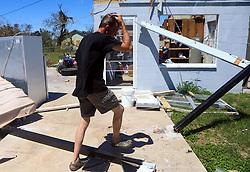 August 29, 2017 - Woodsboro, Texas, U.S. - DEAN WEILTZEL walks past fallen beams after Hurricane Harvey destroyed his home on Tuesday. (Credit Image: © Gabe Hernandez/TNS via ZUMA Wire)