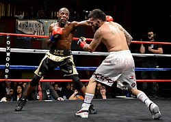 October 20, 2018 - Mashantucket, CT, U.S. - MASHANTUCKET, CT - OCTOBER 20: Carlos Hernandez  (black gloves) takes on Marqus Bates (red gloves) in a Welterweight bout on October 20, 2018, at the Foxwoods Casino in Mashantucket, CT. Marqus Bates defeats Carlos Hernandez via decision.  (Photo by Williams Paul/Icon Sportswire) (Credit Image: © Williams Paul/Icon SMI via ZUMA Press)