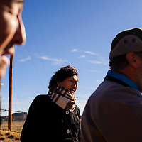 112214       Cable Hoover<br /> <br /> Narangerel Rinchin , center, listens as Paul Robinson describes the history of the area during a tour of UNC section 17 in Churchrock Saturday.