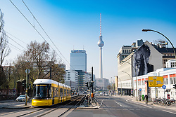 """""""JR"""" mural on building wall and Television Tower in Berlin Germany"""