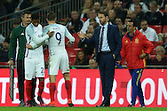 Gareth Southgate, the England interim manager congratulates Jamie Vardy of England as he is replaced by Marcus Rashford. England v Spain, Football international friendly at Wembley Stadium in London on Tuesday 15th November 2016.<br /> pic by John Patrick Fletcher, Andrew Orchard sports photography.