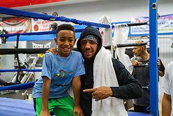 Rancho Cucamonga, California/USA (Tuesday, Nov 12 2013) - Super middleweight champion Andre Ward (26-0, 14 KOs) poses with a young fan after finishing off his open workout during the Ward vs Rodriguez Media Workout at the Warzone Boxing Club in Rancho Cucamonga, CA USA. Andre have not fought in over a year due to right shoulder surgery. He is facing Edwin Rodriguez (24-0, 16 KOs) at the Citizens Business Bank Arena in Ontario, California. The Ward-Rodriguez bout will be televised live on HBO at 9:30PM PST. PHOTO © SILVEXPHOTO.COM.