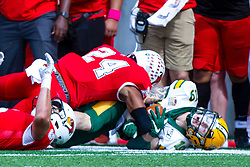 NORMAL, IL - October 05: Christian Uphoff brings down Jimmy Kepouros to the ground pretty hard during a college football game between the ISU (Illinois State University) Redbirds and the North Dakota State Bison on October 05 2019 at Hancock Stadium in Normal, IL. (Photo by Alan Look)