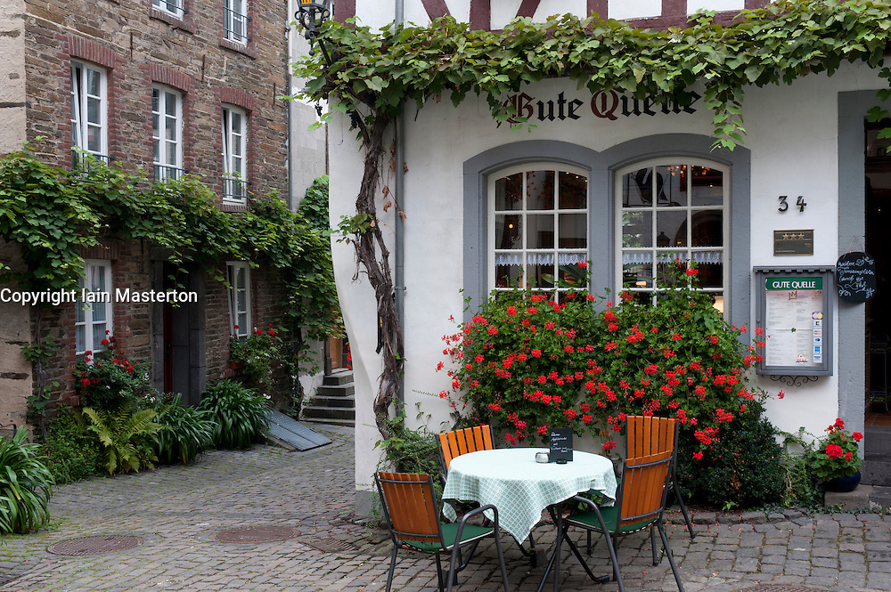Cafe and historic houses in Beilstein village on River Mosel in Rhineland-Palatinate Germany