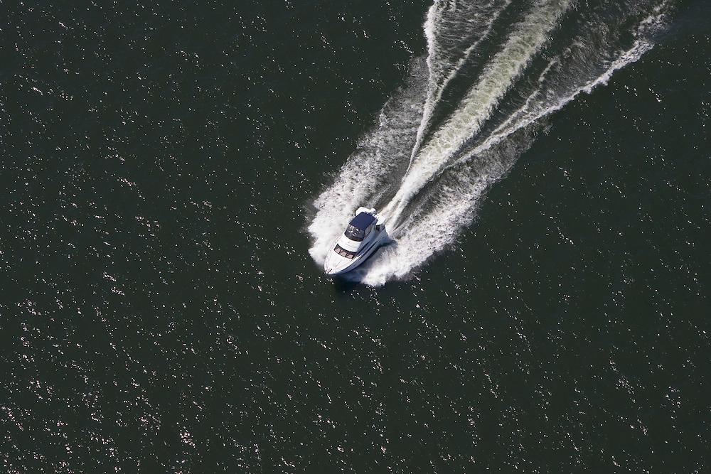 A pleasure craft glides across the waters of Green Bay in Door County, Wisconsin.