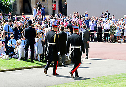 The Duke of Cambridge (left) and Prince Harry (right) arrive at St George's Chapel at Windsor Castle for his wedding.